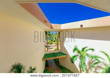 Cayo Coco island, Cuba, Sol Cayo Coco, July 17, 2017, view of hotel building architecture inside walls with window leading to tropical garden