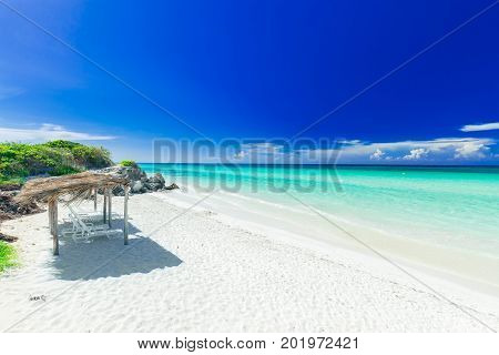 stunning, amazing inviting view of tropical white sand beach and tranquil turquoise ocean on dark deep, blue sky background at Cayo Coco Cuban island, sunny summer beautiful day