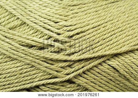 A super close up image of split pea green yarn