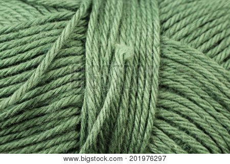 A super close up image of green yarn