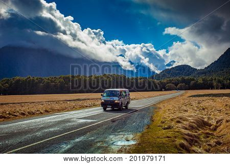 KNOBS FLAT NEW ZEALAND - AUGUST 302015 : tourist van passing knobs flat area important traveling route on te-anau to milfordsound highway on august 302015 in south island new zealand