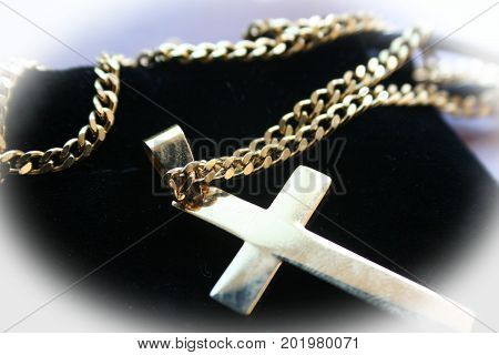 Golden Catholic Cross With White Frame Close Up