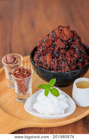 Bing Choo Chocolate ice cream with biscuit and honey put on wooden plate and tabletop
