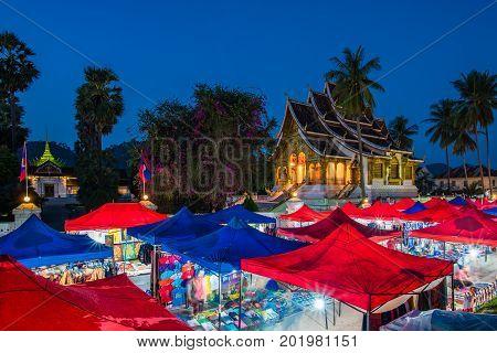 Luang Prabang, Laos - December 19, 2015: A famous walking street in the world heritage site, Luang Prabang, Laos.