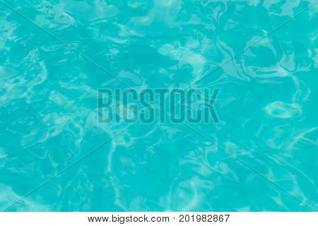 Ripple Water surface in swimming pool with sun reflection Shining blue water ripple background