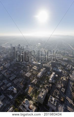 Sunny afternoon aerial view of urban streets and towers in downtown Los Angeles, California.