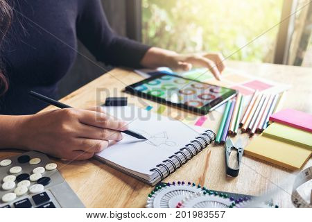 Young woman dressmaker or designer working as fashion designers and drawing sketches for clothes profession and job occupation Fashion Designer Stylish Concept.