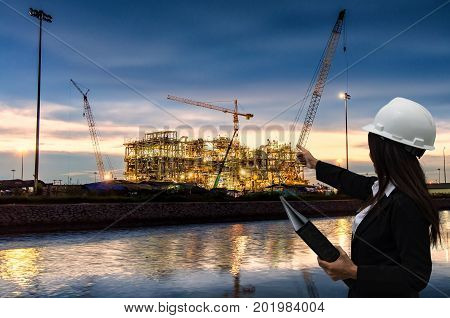 EngineerConstructionClose up industrial view Oil tank with oil and gas refinery area at night background