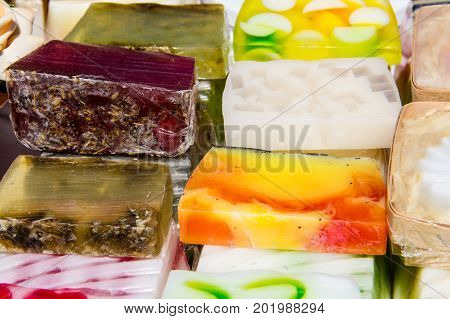 Stack Of Different Natural Handmade Soaps On Retail Market