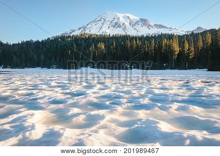Mount Rainier from a snow-covered Reflection Lake in June