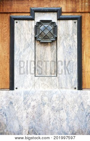 Metal sconce on marble background outdoors wall