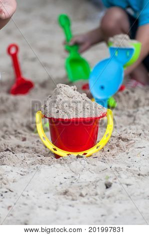Kids On White Sand Sandbox And Antimony Of Children Play