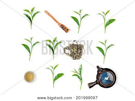 Tea Leaves, Tea Cup, Tea Pot And Wooden Scoop On White Background. Top View