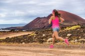 Trail runner athlete woman running training cardio on rocky mountain path on long distance endurance run in summer outdoors nature landscape. Female sports fitness person working out. poster