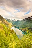 Tourism vacation and travel. Beautiful view over magical Geirangerfjorden from Flydalsjuvet viewpoint Norway Scandinavia. poster