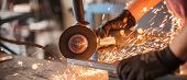Electric wheel grinding on steel structure in factory. Sparks from the grinding wheel poster