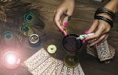Tarot cards on fortune teller table. Divination. Witchcraft. Witch prepares a magic potion. poster