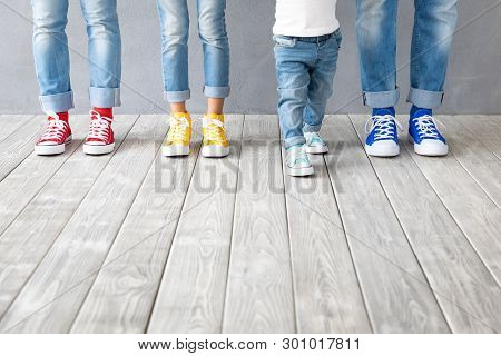 People's Feet In Colorful Sneakers