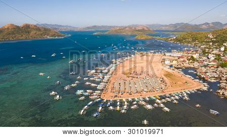 Berth With Boats In The Town Of Coron. Palawan. Philippines.coron Cityscape With Pier And Sulu Sea.c