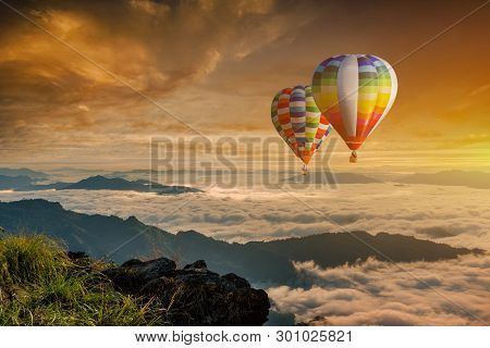 Colorful Hot-air Balloons Flying Over The Mountain At Phucheefa,chiangrai Province ,north Of Thailan