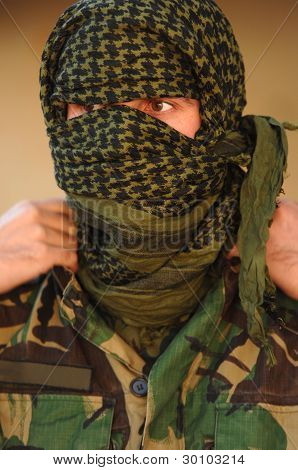 Military preparing camouflage