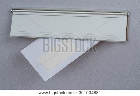 A Letter With Copy Space In A Mail Slot