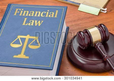 A Law Book With A Gavel  - Financial Law