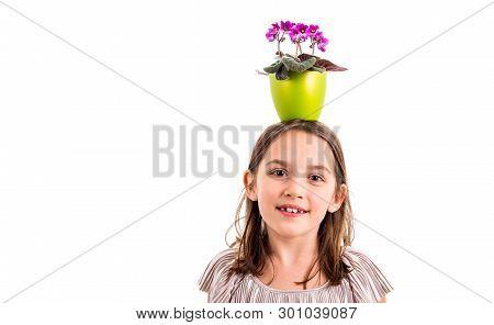 Girl Carrying Flower Pot On Head, Having Fun Smiling.