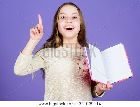 Got Great Plans For Education. Cute Small Child Keeping Finger Raised And Open Education Book. Adora