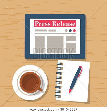 Press Release Concept. Tablet Computer With News In On A Wooden Table. Cup Of Coffee And A Notebook.