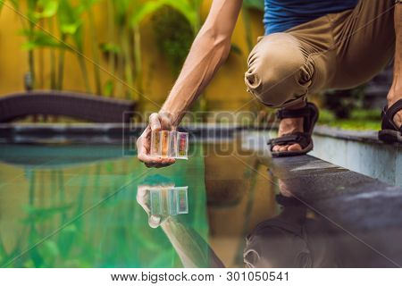 Pool Worker Checks The Pool For Safety. Measurement Of Chlorine And Ph Of A Pool