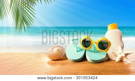 Sunblock With Flip Flops On The Tropical Beach And Sunshine