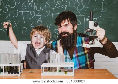 Back To School. Elementary School Teacher And Student In Classroom. Home Schooling. Father Teaching