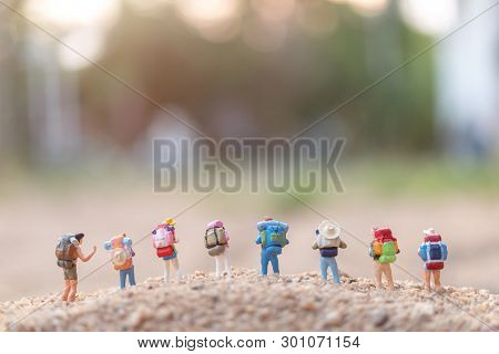 Miniature People : Traveler With Backpack Walking  On Sand