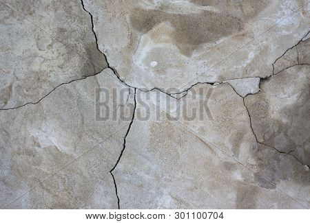 Heterogeneous Gray Concrete Wall Background With Crack.