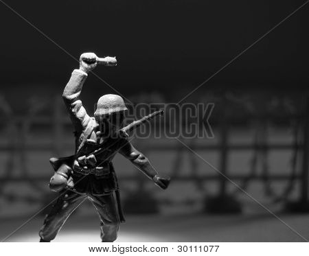 Toy soldier with grenade