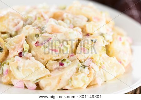 Fresh Homemade Vegetarian Potato Salad Made With Red Onion, Pickles, Mayonnaise And Mustard Served O