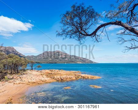 A Beach At Coles Bay, Adjacent To Freycinet National Park In Tasmania, Australia.