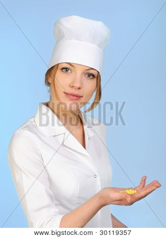 Smiling Medical Doctor Woman Holding Pill