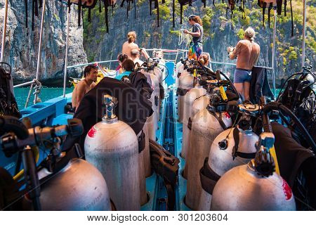 Phi Phi Island, Thailand, March 2013 Group Of Scuba Divers Preparing For Scuba Diving On A Boat Full