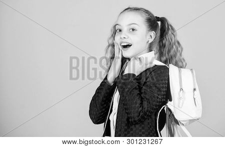 Girl little fashionable cutie carry backpack. Popular useful fashion accessory. Schoolgirl ponytails hairstyle with small backpack. Carrying things in backpack. Learn how fit backpack correctly poster