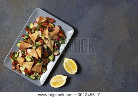 Traditional Fattoush Salad  With Vegetables And Pita Bread.  Levantine, Arabic, Middle Eastern Cuisi
