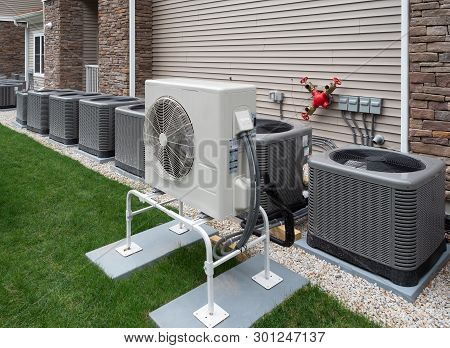 Modern Air Conditioning And Heating Units Or Heat Pumps, Used In Homes And Apartments Without Centra