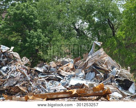 Piles Of Scrap From A Demolished Mall Is Sorted By Type Of Materials From Structural To Flat Roll To