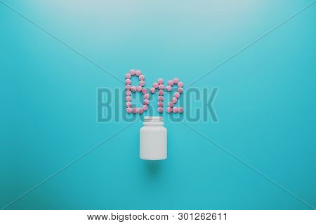 Pink Pills In The Shape Of The Letter B12 On A Blue Background, Spilled Out Of A White Can, Low Cont