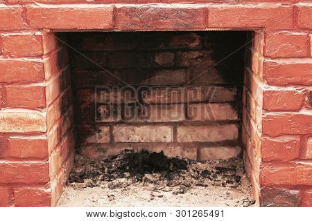 Red Brick Dirty Fireplace With Remains Of Ash After Wooden Firewood Burnt In Fireplace As Advertisin