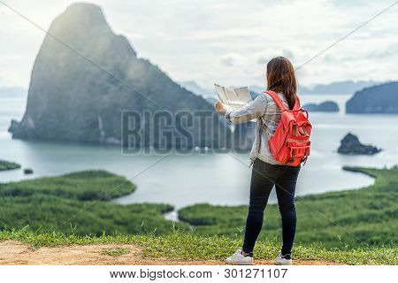 Back Side Of Asian Woman Traveler Looking The Map For Travel With Backpacker At Fantastic Landscape