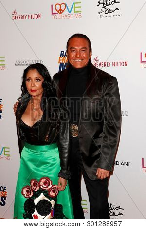 LOS ANGELES - MAY 10:  Nick Chavez, Apollonia Kotero at the Race to Erase MS Gala at the Beverly Hilton Hotel on May 10, 2019 in Beverly Hills, CA