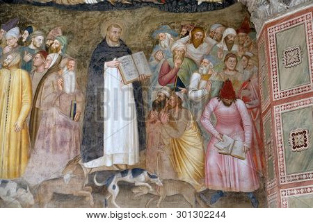 FLORENCE, ITALY - JANUARY 10, 2019: Saints Peter the Martyr and Thomas Aquinas Refute the Heretics, detail of the Active and Triumphant Church, Santa Maria Novella Dominican church in Florence