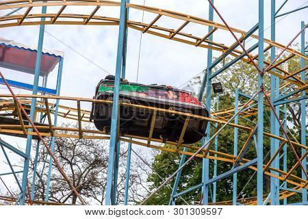 Odessa, Ukraine - May 6, 2019: Visitors Ride Road Slides In An Amusement Park. Young Friends On An E